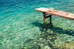 Wooden pier over beautiful adriatic sea Stock Image