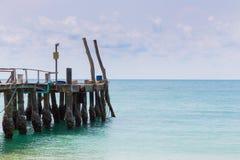 Wooden pier over natural beach skyline. Natural landscape skyline background Stock Images
