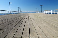 Wooden pier over a sea Royalty Free Stock Image