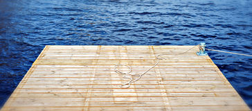 Wooden pier over a water. The image was taken by spring day at abeach of a big lake Stock Photo