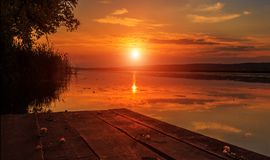 Wooden pier over the water. at sunset. Wooden pier over the water at sunset Stock Photo