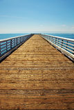 Wooden Pier at Pacific coast Stock Photo
