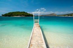 Wooden pier on paradise beach in Ksamil in Albania stock photo
