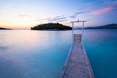 Wooden pier on paradise beach in Ksamil during sunset in Albania stock images