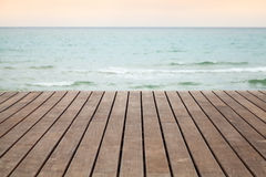 Wooden pier perspective with blue sea Stock Images