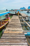 The wooden pier in Phang Nga bay. The bay is in Phang Nga bay national park of Thailand Royalty Free Stock Image