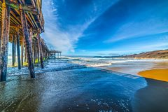 Wooden pier in Pismo beach seen from the foreshore. California, USA Royalty Free Stock Photography