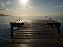 Wooden pier, Playa de Muro, Alcudia bay, Spanish island Mallorca. Beautiful island Majorca, Mediterranean Sea, Spain, Europe Royalty Free Stock Photos