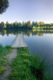 Wooden pier on the pond Royalty Free Stock Photos