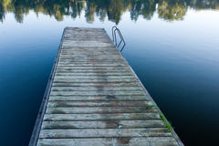 Wooden pier on the pond Stock Images