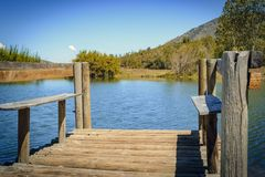 Wooden pier on the pond royalty free stock photography