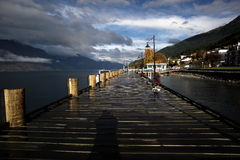 Wooden pier in Queenstown NZ Stock Images