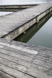 Wooden pier by the river background royalty free stock image