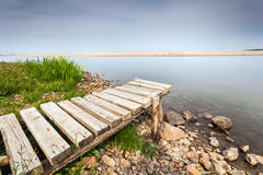 Wooden pier by the river mouth Royalty Free Stock Photo