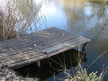 Wooden pier on the river. Old fishing wooden pier on the river stock images