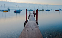 Wooden Pier and Sailboats Royalty Free Stock Photos