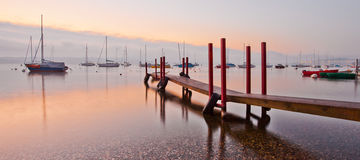 Wooden Pier and Sailboats Stock Photos