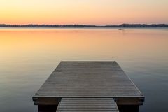 Wooden pier in the Scandinavian evening lake Royalty Free Stock Photography