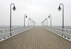 Wooden pier on the sea Royalty Free Stock Images