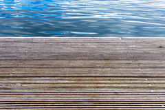 Wooden pier with sea in background Stock Photos