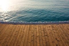 Wooden pier on the sea royalty free stock image