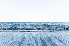 Wooden pier with sea Stock Images