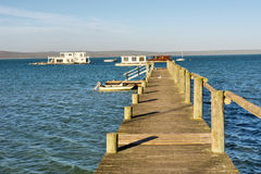 Wooden pier in sea lagoon Royalty Free Stock Photography