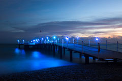 Wooden pier on the sea. After sunset Royalty Free Stock Photos