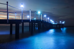 Wooden pier on the sea. After sunset Stock Images
