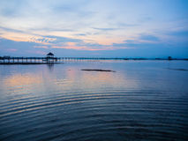Wooden pier into the sea. Sunset behind wooden pier on Mak Island in Trad,  Thailand Royalty Free Stock Photo