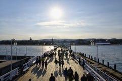The wooden pier on September 30, 2017 in Sopot, Poland. SOPOT, POLAND: SEPTEMBER 30, 2017: Tourists walking on the wooden pier on September 30, 2017 in Sopot stock photography