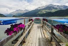 Wooden pier on Sils Lake Royalty Free Stock Photo