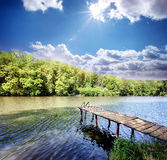 Wooden pier in the small lake Royalty Free Stock Image