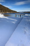 Wooden pier with snow at Lake Tahoe Royalty Free Stock Images