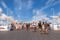 Wooden Pier in Sopot. The many tourists on the largest European wooden pier in summer sunny day, on August 9, 2015 in Sopot, Poland stock photo