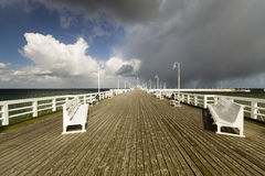 Wooden pier in Sopot sea during a storm, Poland Royalty Free Stock Image