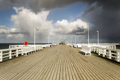 Wooden pier in Sopot sea during a storm, Poland Royalty Free Stock Photo
