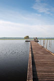 Wooden pier on Soustons lake, France Royalty Free Stock Photo