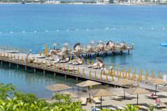 Wooden Pier with sunbeds on the beach in a hotel resort in Bodrum ,Turkey Stock Photography