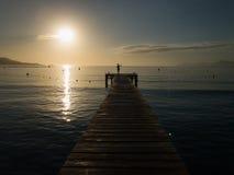 Wooden pier, sunrise in Playa de Muro, Mallorca. Beautiful island Majorca, Mediterranean Sea, Spain, Europe Royalty Free Stock Photo