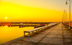 Wooden pier at sunrise Stock Photos