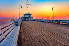 Wooden pier at sunrise. Sunrise at wooden pier in Sopot, Poland royalty free stock photo