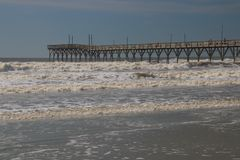 Wooden Pier at Sunset Beach, North Carolina. Sunset Beach Pier in the Atlantic Ocean on Sunset Beach, North Carolina Royalty Free Stock Photography