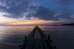 Wooden pier. Sunset at an old wooden pier on the island of Koh Kood in Thailand Stock Image
