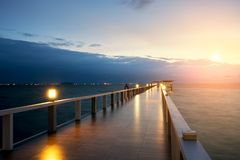 Wooden pier between sunset in Phuket, Thailand. Summer, Travel, Royalty Free Stock Image