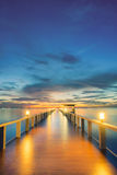 Wooden pier between sunset in Phuket, Thailand Royalty Free Stock Photos