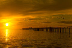 Wooden pier between sunset in Phuket, Thailand Royalty Free Stock Photography