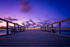 Wooden pier at sunset Royalty Free Stock Photo