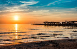 Wooden pier sunset. Sea and wooden pier sunset, Sventoji, Lithuania Royalty Free Stock Images