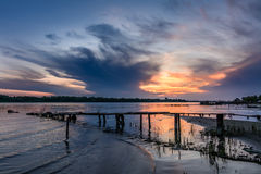 Wooden pier at sunset in the summer. Horizontal view of a wooden Royalty Free Stock Image